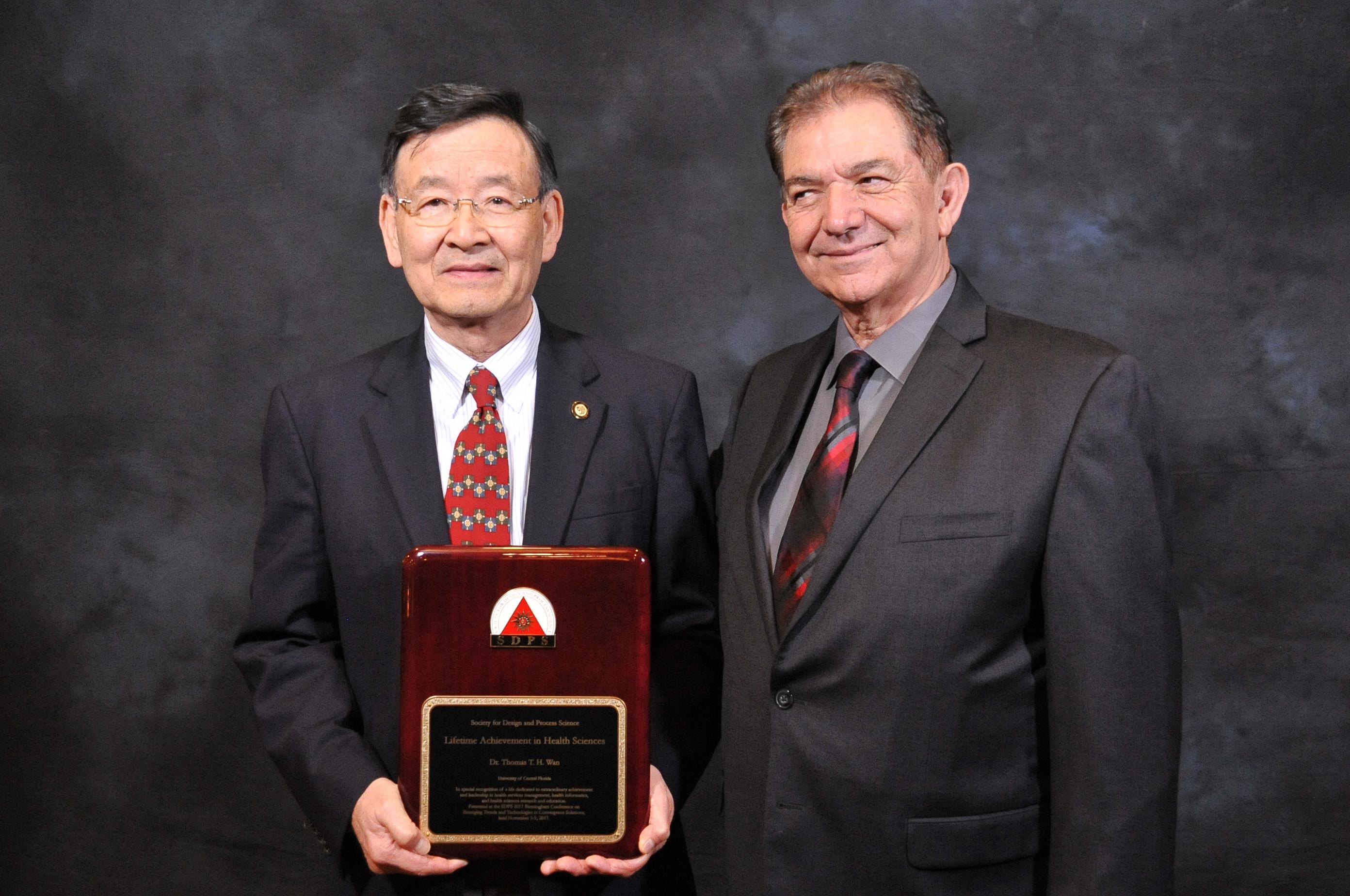 A participant receives a lifetime achievement award during this Nashville Red Carpet Photography event