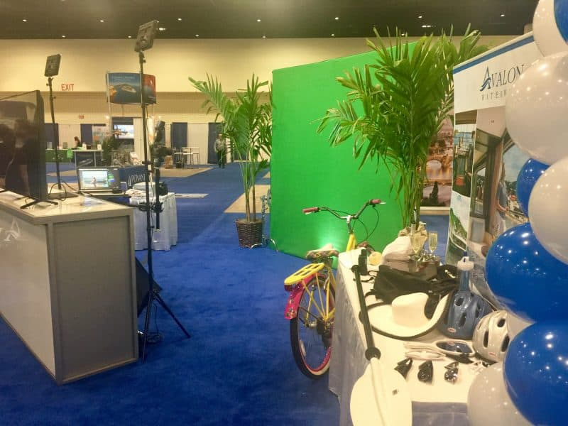 A Chicago experiential photo marketing booth at a local event featuring green screen photography