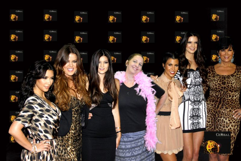 A Houston Green Screen Photo Booth featuring a fake red carpet with the Kardashians