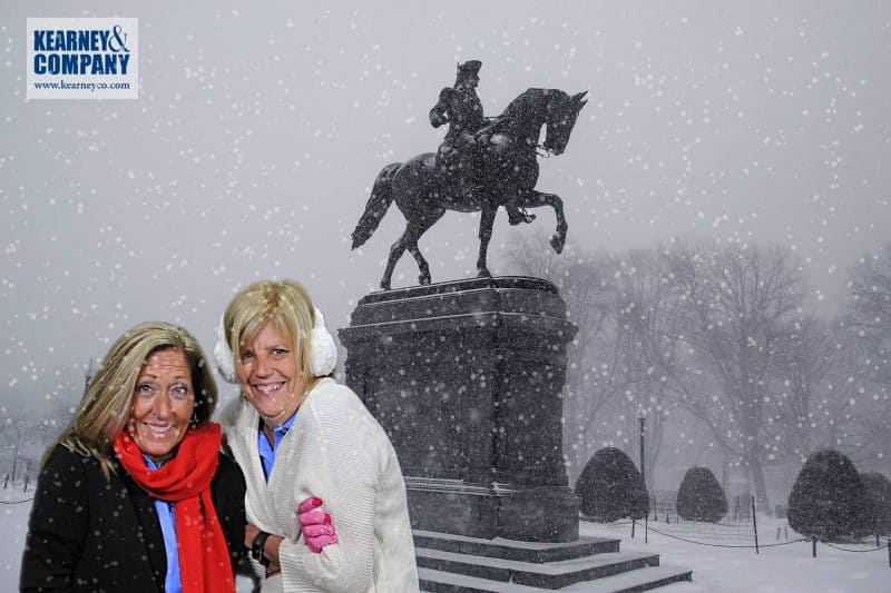 Two participants shiver in the cold during this Boston green screen photo booth