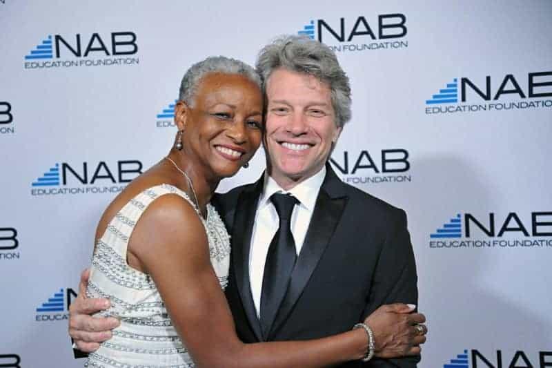 Singer Jon Bon Jovi meets a participant during a Phoenix Red Carpet Photography event.