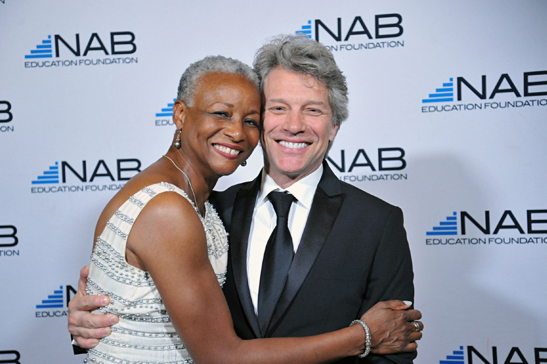 Singer Jon Bon Jovi meets a participant during a Phoenix Red Carpet Photography event.