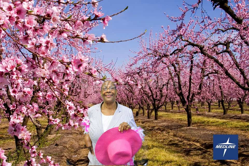 A participant poses in nearby Atlanta peach orchard in this green screen photography photo.