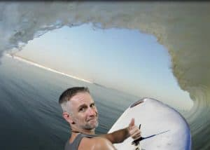 An event participant catches a wave and surfs for this Miami green screen photography event