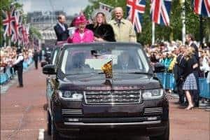 an Orlando green screen photo booth participant joins Queen Elizabeth in a parade.