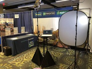 Corporate headshot photography at events. This headshot photo booth for Enterprise holdings fit inside a 10' x 15' booth.