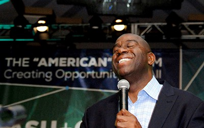 Magic Johnson address a Baltimore convention about his foundation.