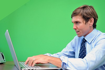 Baltimore corporate green screen photography for websites and content marketing. An attorney at his desk,