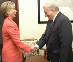 Lech Walesa greets former Senator Hillary Clinton