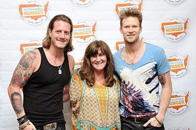 Florida Georgia line band members meet a participant in Philadelphia